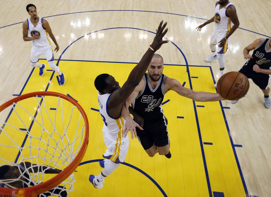 San Antonio Spurs' Manu Ginobili (20) drives to the basket as Golden State Warriors' Draymond Green, center left, defends during the first half of Game 2 of the NBA basketball Western Conference finals, Tuesday, May 16, 2017, in Oakland, Calif. (AP Photo/Marcio Jose Sanchez)
