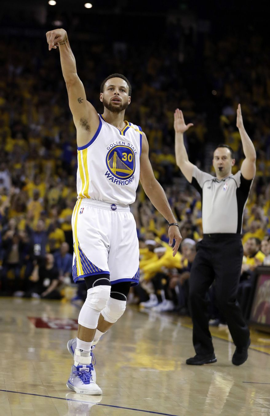 Golden State Warriors' Stephen Curry follows through as he scores against the San Antonio Spurs during the first half of Game 2 of the NBA basketball Western Conference finals, Tuesday, May 16, 2017, in Oakland, Calif. (AP Photo/Marcio Jose Sanchez)