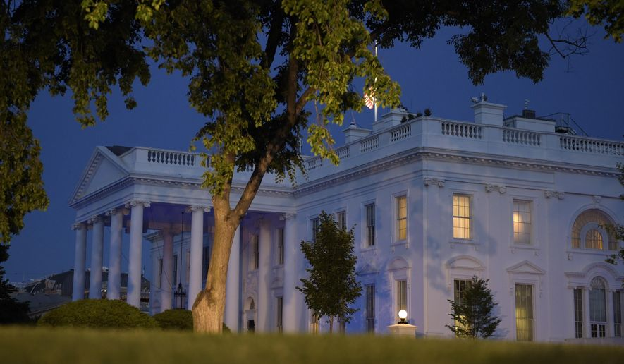 The White House is lit in blue to honor police officers killed in the line of duty on Monday, May 15, 2017, in Washington. (AP Photo/Susan Walsh)