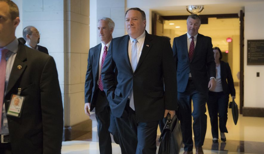 wldCIA Director Mike Pompeo departs the Capitol after briefing members of the House Intelligence Committee in the aftermath of President Donald Trump reportedly sharing classified information with two Russian diplomats during a meeting in the Oval Office, in Washington, Tuesday, May 16, 2017. (AP Photo/J. Scott Applewhite)