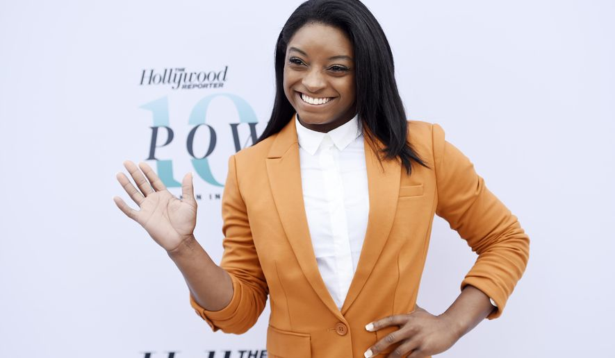 """FILE - In this Dec. 7, 2016 file photo U.S. Olympic gymnast Simone Biles waves to photographers at The Hollywood Reporter's 25th Annual Women in Entertainment Breakfast in Los Angeles. Biles was eliminated from ABC's """"Dancing with the Stars"""" on Monday, May 15, 2017. (Photo by Chris Pizzello/Invision/AP, File)"""