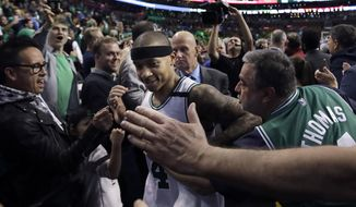 Fans congratulate Boston Celtics guard Isaiah Thomas after Game 7 of a second-round NBA basketball playoff series, Monday, May 15, 2017, in Boston. The Celtics won 115-105 to advance to the Eastern Conference championship series. (AP Photo/Charles Krupa)