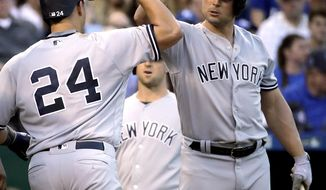 New York Yankees' Gary Sanchez (24) celebrates with Matt Holliday after hitting a three-run home run during the third inning of a baseball game against the Kansas City Royals on Tuesday, May 16, 2017, in Kansas City, Mo. (AP Photo/Charlie Riedel)