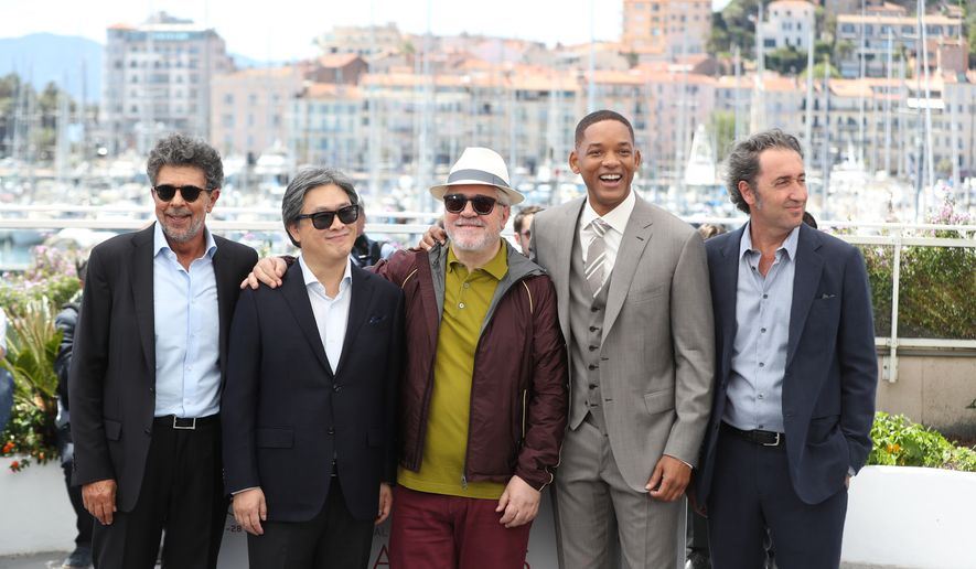 Jury members Gabriel Yared, from left, Park Chan-wook, Pedro Almodovar, Will Smith and Paolo Sorrentino pose for photographers during the photo call for the Jury at the 70th international film festival, Cannes, southern France, Tuesday, May 16, 2017. (AP Photo/Alastair Grant)