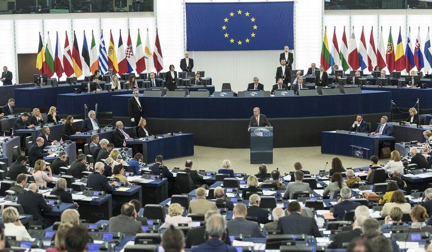 U.N. Secretary General Antonio Guterres, center, addresses the European Parliament, while EU Parliament president Antonio Tajani leaves in Strasbourg, eastern France, Wednesday, May 17, 2017. (AP Photo/Jean-Francois Badias)