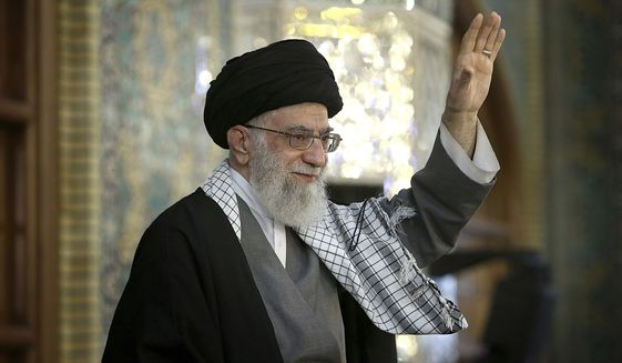 In this March 21, 2017 file photo, released by an official website of the office of the Iranian supreme leader, Supreme Leader Ayatollah Ali Khamenei waves to a crowd in a trip to the northeastern city of Mashhad, Iran. (Office of the Iranian Supreme Leader via AP, File)