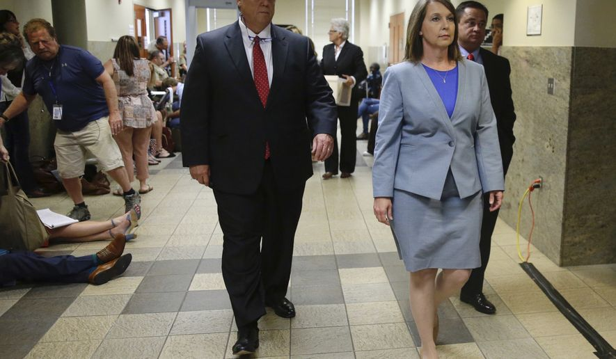Tulsa Police Officer Betty Shelby, right, leaves the courthouse to wait for a verdict with attorney Scott Wood in her manslaughter trial in the shooting of Terence Crutcher, Wednesday, May 17, 2017, in Tulsa, Okla.  (Mike Simons/Tulsa World via AP)