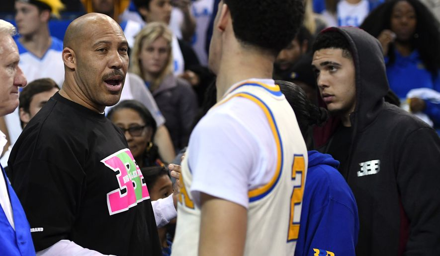 """FILE - In this March 4, 2017, file photo, UCLA guard Lonzo Ball, right, shakes hands with his father LaVar following an NCAA college basketball game against Washington State in Los Angeles. The outspoken father of former UCLA star Lonzo Ball said Wednesday, May 17, on Fox Sport 1's """"The Herd with Colin Cowherd"""" that it will now cost a shoe company $3 billion to make a deal with his Big Baller Brand. (AP Photo/Mark J. Terrill, File)"""