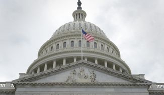 The U.S. flag flies in front of the Capitol dome on Capitol Hill in Washington on May 4, 2017. (Associated Press) **FILE**