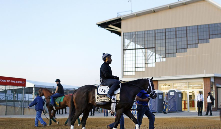 Kentucky Derby winner Always Dreaming, ridden by exercise rider Nick Bush, walks past the grandstand after a workout at Pimlico Race Course in Baltimore, Wednesday, May 17, 2017. The Preakness Stakes horse race is scheduled to take place May 20. (AP Photo/Patrick Semansky)