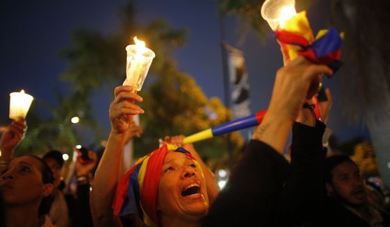 Demonstrators hold candles during a vigil for the victims of the clashes with the government's security forces, during protest against President Nicolas Maduro in Caracas, Venezuela, Wednesday, May 17, 2017. Several humanitarian organizations and the opposition have accused the security forces of using too much violence during demonstrations against the government, which have left dozens dead.(AP Photo/Ariana Cubillos)