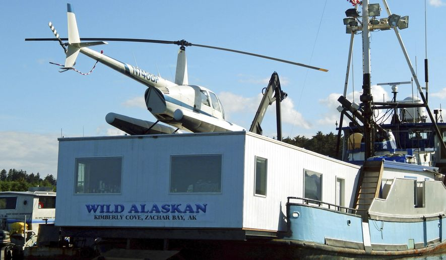 """FILE - This 2014 file photo, shows the Wild Alaskan, a converted crabbing boat that had been used as a strip club, moored near downtown Kodiak, Alaska. Its owner, Darren Byler, is resurrecting the controversial strip club on board his boat, billing the enterprise as a nightly protest months after he was sentenced to probation for dumping human waste from the vessel. Byler, who is appealing the case, says he will begin his summer-long """"First Amendment Freedom of Assembly"""" protests, complete with exotic dancers, Thursday May 18, 2017. (Kodiak Daily Mirror via AP, File)"""