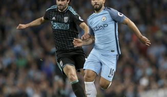 West Bromwich Albion's Claudio Yacob, left, and Manchester City's Sergio Aguero battle for the ball during the English Premier League soccer match against Manchester City at the Etihad Stadium, Manchester, England, Tuesday May 16, 2017. (Martin Rickett/PA via AP)