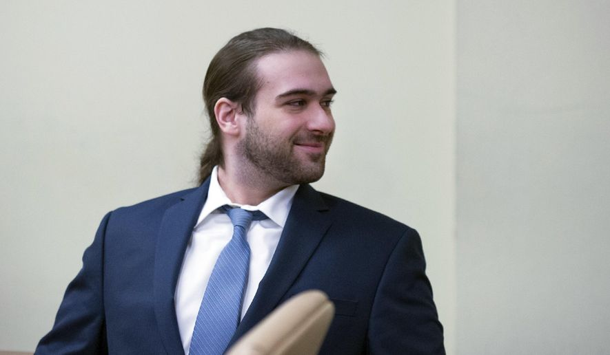 """David """"D.J."""" Creato Jr. looks back during his trial Wednesday, May 17, 2017, in Camden, N.J. Creato is accused of killing his 3-year-old son in October 2015. (Joe Lamberti/Camden Courier-Post via AP, Pool)"""