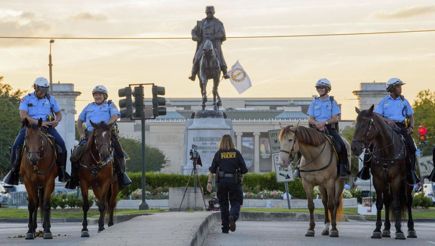 New Orleans Police Mounted Patrol stand by the Gen. P.G.T. Beauregard Confederate monument in City Park after moving the public back in New Orleans, La. Tuesday, May 16, 2017.  Workers in New Orleans took down a Confederate monument to Gen. P.G.T. Beauregard early Wednesday.  (Matthew Hinton/The Advocate via AP)