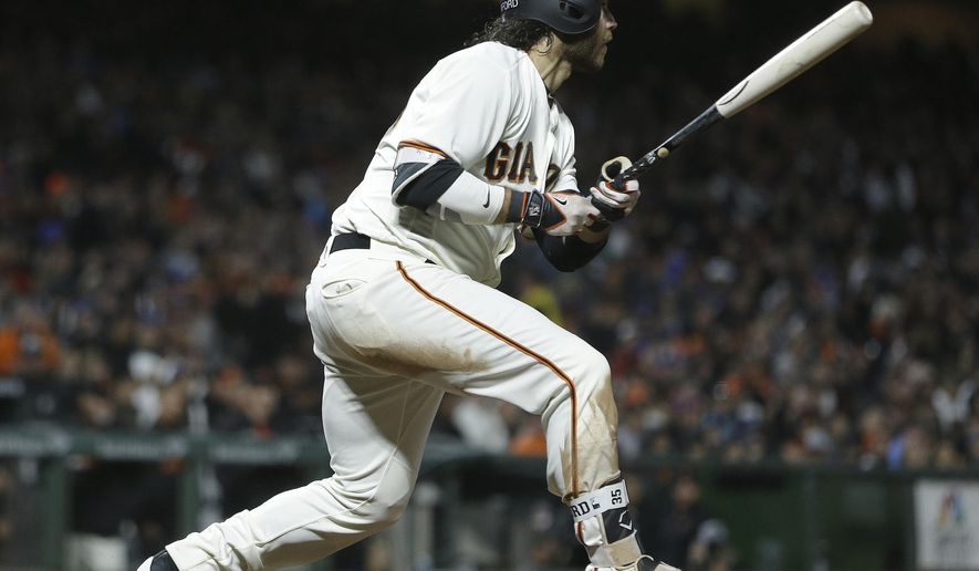 San Francisco Giants' Brandon Crawford watches his RBI single off Los Angeles Dodgers' Rich Hill during the sixth inning of a baseball game Tuesday, May 16, 2017, in San Francisco. (AP Photo/Ben Margot)