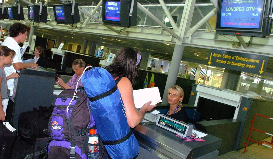In this Aug. 11, 2006, file photo, passengers en route to London check in at Biarritz airport, southwestern France. U.S. and European officials will discuss Wednesday, May 17, 2017, plans to broaden a U.S. ban on in-flight laptops and tablets to include planes from Europe. (AP Photo/Bob Edme, File)