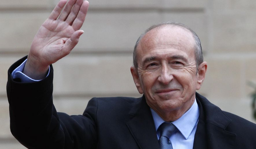 Lyon mayor Gerard Collomb waves as he arrives at the Elysee Palace Sunday, May 14, 2017 in Paris. Collomb has been named as French Interior Minister Wednesday, May 17, 2017. (AP Photo/Christophe Ena, File)
