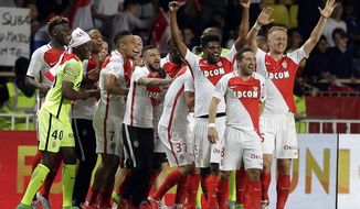 Monaco players celebrate their goal during the League One soccer match Monaco against Saint Etienne, at the Louis II stadium in Monaco, Wednesday, May 17, 2017. (AP Photo/Claude Paris)