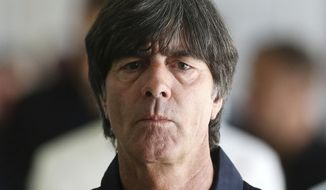 Coach of German national soccer team Joachim Loew approaches a press conference announcing the team for the Confederations Cup in Frankfurt, Germany, Wednesday, May 17, 2017. (AP Photo/Michael Probst)