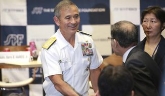 U.S. Pacific Command Commander Adm. Harry Harris Jr. shakes hands with guests after deliverinfg a speech at the Sasakawa Peace Foundation, Wednesday, May 17, 2017, in Tokyo. (AP Photo/Eugene Hoshiko)
