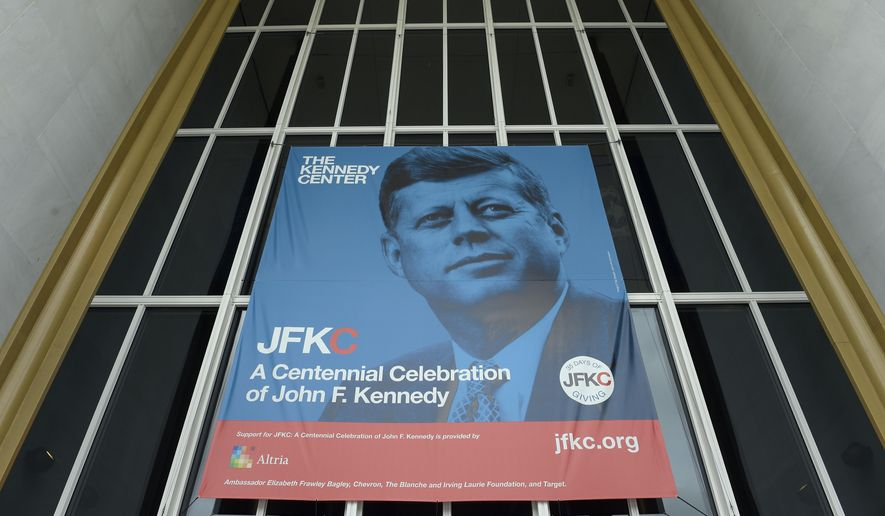 """A poster hangs outside the Kennedy Center in Washington, Friday, May 5, 2017. This year, in honor of the 100th anniversary of JFK's birth, leaders of the performing arts behemoth are trying to put the Kennedy back into the Kennedy Center, reemphasizing its role as a """"living memorial"""" to the slain 35th president. (AP Photo/Susan Walsh)"""