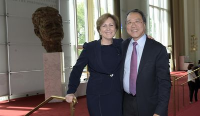 "Kennedy Center President Deborah Rutter, left, and Internationally renowned cellist Yo-Yo Ma, right, pose for a photo at the Kennedy Center in Washington, Friday, May 5, 2017. This year, in honor of the 100th anniversary of JFK's birth, leaders of the performing arts behemoth are trying to put the Kennedy back into the Kennedy Center, reemphasizing its role as a ""living memorial"" to the slain 35th president. (AP Photo/Susan Walsh)"
