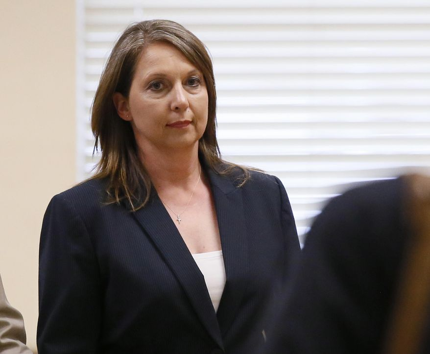 FILE - In this Friday, May 12, 2017, file photo, Betty Shelby leaves the courtroom following testimony in her trial in Tulsa, Okla. Shelby, who fatally shot an unarmed black man last year, was found not guilty Wednesday of first-degree manslaughter. (AP Photo/Sue Ogrocki, File)