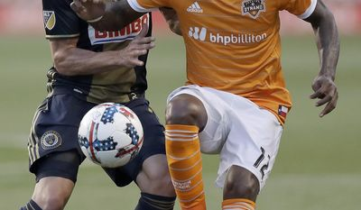 Philadelphia Union forward Chris Pontius, left, goes after the ball against Houston Dynamo forward Romell Quioto during the first half of an MLS soccer match Wednesday, May 17, 2017, in Chester, Pa. (Yong Kim/The Philadelphia Inquirer via AP)