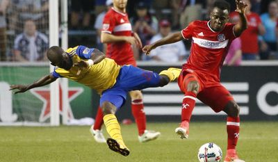 Chicago Fire midfielder David Accam, right, controls the ball against Colorado Rapids midfielder Micheal Azira during the first half of an MLS soccer match, Wednesday, May 17, 2017, in Bridgeview, Ill. (AP Photo/Nam Y. Huh)