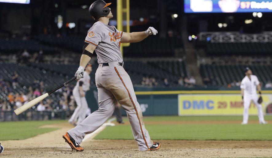 Baltimore Orioles' Chris Davis watches his two-run home run during the 13th inning of a baseball game against the Detroit Tigers, Wednesday, May 17, 2017, in Detroit. (AP Photo/Carlos Osorio)