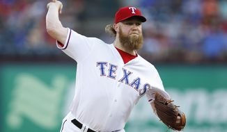 Texas Rangers starting pitcher Andrew Cashner delivers to the Philadelphia Phillies during the first inning of a baseball game, Wednesday, May 17, 2017, in Arlington, Texas. (AP Photo/Jim Cowsert)
