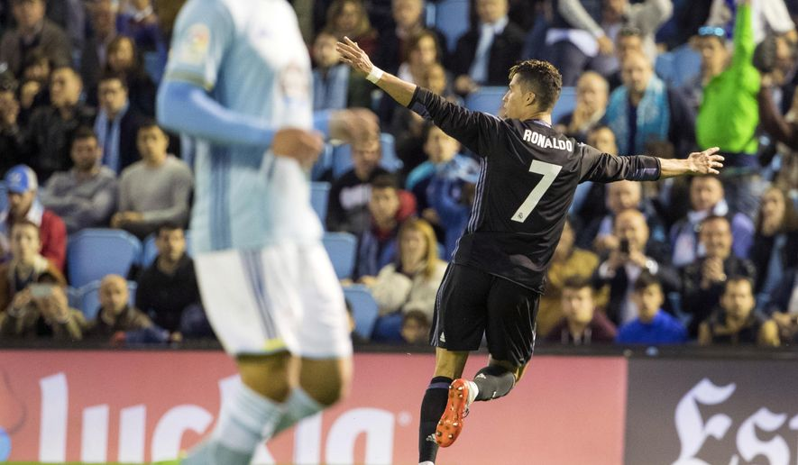 Real Madrid's Cristiano Ronaldo, right, celebrates after scoring the second goal against Celta during a Spanish La Liga soccer match between Celta and Real Madrid at the Balaidos stadium in Vigo, northern Spain, Wednesday, May 17, 2017. (AP Photo/Lalo R. Villar)