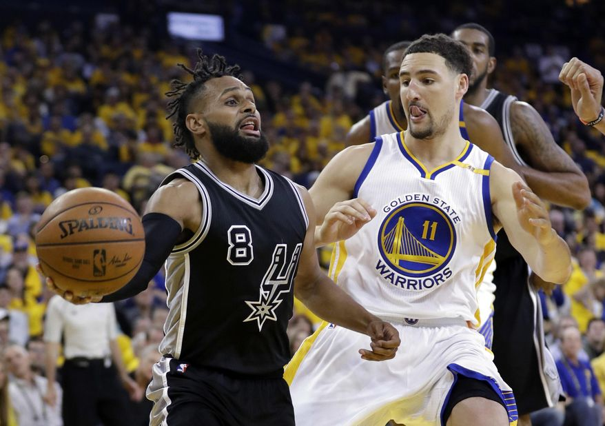 San Antonio Spurs' Patty Mills (8) is defended by Golden State Warriors' Klay Thompson (11) during the second half of Game 2 of the NBA basketball Western Conference finals, Tuesday, May 16, 2017, in Oakland, Calif. (AP Photo/Marcio Jose Sanchez)