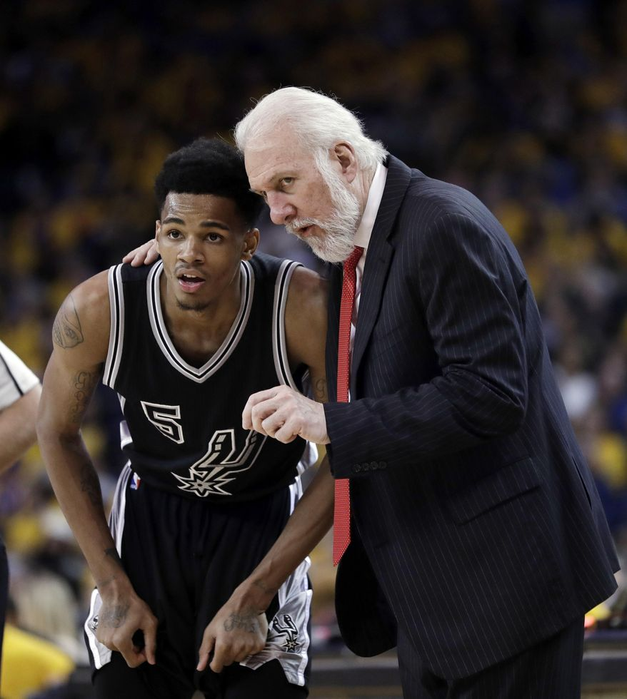 San Antonio Spurs coach Gregg Popovich, right, talks to guard Dejounte Murray during the second half of Game 2 of the NBA basketball Western Conference finals against the Golden State Warriors, Tuesday, May 16, 2017, in Oakland, Calif. (AP Photo/Marcio Jose Sanchez)