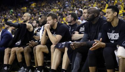 Members of the San Antonio Spurs watch from the bench during the second half of Game 2 of the NBA basketball Western Conference finals against the Golden State Warriors, Tuesday, May 16, 2017, in Oakland, Calif. (AP Photo/Marcio Jose Sanchez)