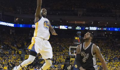 Golden State Warriors' Draymond Green (23) drives to the basket as San Antonio Spurs' LaMarcus Aldridge watches during the first half of Game 2 of the NBA basketball Western Conference finals, Tuesday, May 16, 2017, in Oakland, Calif. (Kyle Terada/Pool via AP)