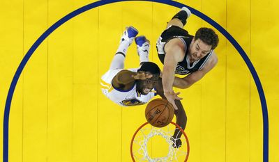 Golden State Warriors' Draymond Green, bottom, works for a rebound against San Antonio Spurs' Pau Gasol during the first half of Game 2 of the NBA basketball Western Conference finals, Tuesday, May 16, 2017, in Oakland, Calif. (AP Photo/Marcio Jose Sanchez)