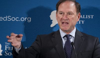FILE -In this Nov. 17, 2016 file photo, Supreme Court Justice Samuel Alito speaks at the Federalist Society's National Lawyers Convention in Washington. Alito is giving the graduation address at a historic Roman Catholic seminary near Philadelphia. Alito will also be awarded an honorary degree during Wednesday's ceremony, May 17, 2017, at the Saint Charles Borromeo Seminary near Wynnewood. (AP Photo/Cliff Owen, File)