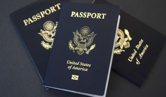 In this May 9, 2017 photo, U.S. passports lie on a table in Dallas, Texas. The U.S. State Department is in the middle of a record year for processing passport applications, with 20.5 million renewals and applications for new passports expected. Adult U.S. passports must be renewed every 10 years, and the 2017 surge comes a decade after a law went into effect requiring passports for U.S. citizens traveling to Mexico, Canada and the Caribbean. (AP Photo/Benny Snyder)