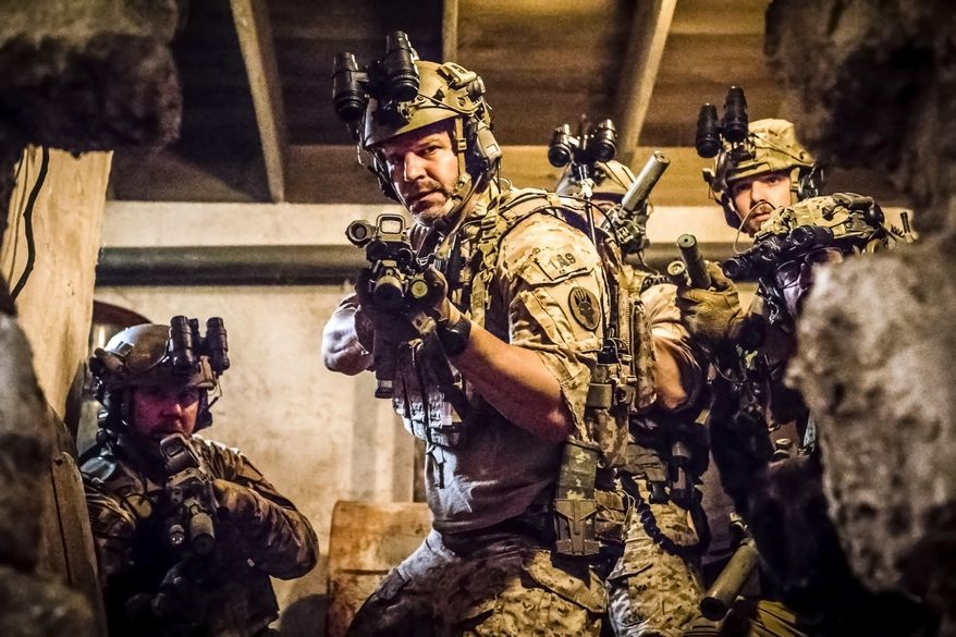 """This image released by CBS shows David Boreanaz as Jason Hayes, center, in a scene from the military drama """"SEAL Team,"""" that follows the professional and personal lives of the most elite unit of Navy SEALs. The show is one of eight new series coming to CBS in the 2017-18 season. (Skip Bolen/CBS via AP)"""