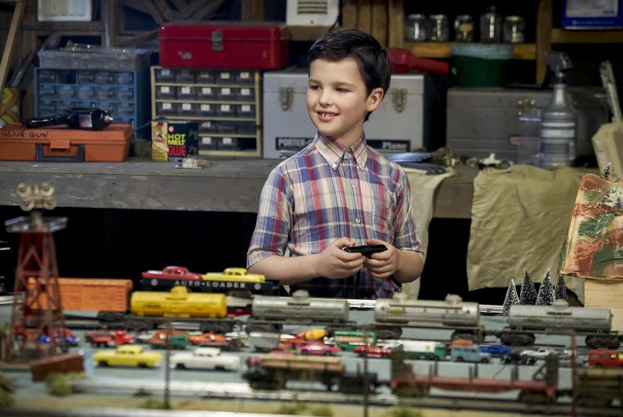 "This image released by CBS shows Iain Armitage in a scene from the news series, ""Young Sheldon,"" premiering Nov. 2, on CBS.  The ""Big Bang"" spinoff, centered on star Jim Parsons' character as a precocious 9-year-old Texas high school student, is one of eight new series coming to CBS in the 2017-18 season.(Robert Voets/CBS via AP)"