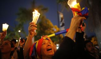 Demonstrators hold candles during a vigil for the victims of the clashes with the governments security forces, during protest against President Nicolas Maduro in Caracas, Venezuela, Wednesday, May 17, 2017. Several humanitarian organizations and the opposition have accused the security forces of using too much violence during demonstrations against the government, which have left dozens dead.(AP Photo/Ariana Cubillos)