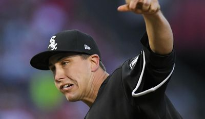 Chicago White Sox starting pitcher Derek Holland throws to the plate during the first inning of a baseball game against the Los Angeles Angels, Tuesday, May 16, 2017, in Anaheim, Calif. (AP Photo/Mark J. Terrill)