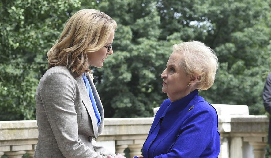 "In this image released by CBS, former Secretary of State Madeleine Albright, right, appears in a scene with actress Tea Leoni, who portrays U.S. Secretary of State Elizabeth McCord in an episode of ""Madam Secretary."" Albright, 78, took a break from teaching duties at Georgetown University to film a guest shot on the show, airing Sunday, Oct. 11, at 8 p.m. EDT on CBS. (Sarah Shatz/CBS via AP)"