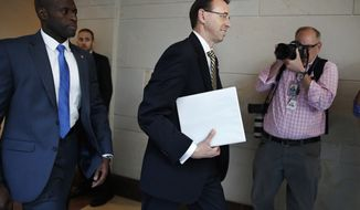 Deputy Attorney General Rod Rosenstein arrives on Capitol Hill in Washington, Thursday, May 18, 2017, for a closed-door meeting with Senators a day after appointing former FBI Director Robert Mueller to oversee the investigation into possible ties between Russia and President Donald Trump's campaign.  (AP Photo/Jacquelyn Martin)