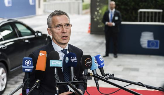 NATO Secretary General Jens Stoltenberg talks with journalists as he arrives for a meeting of EU foreign and defense ministers at the Europa building in Brussels, Thursday May 18, 2017. (AP Photo/Geert Vanden Wijngaert)