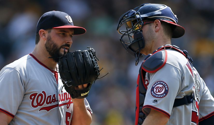 Washington Nationals starting pitcher Tanner Roark, left, talks with catcher Matt Wieters after walking Pittsburgh Pirates' Gift Ngoepe in the sixth inning of a baseball game, Thursday, May 18, 2017, in Pittsburgh. The Pirates won 10-4. (AP Photo/Keith Srakocic)
