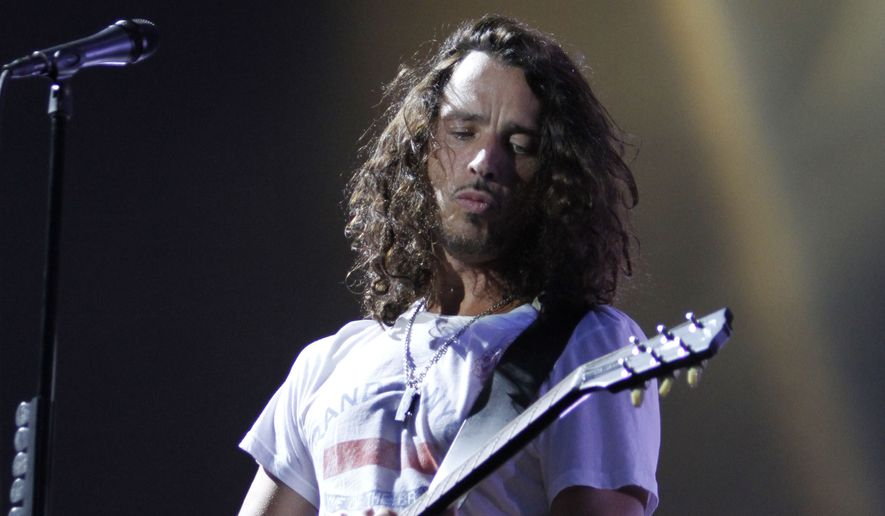 In this Sunday, Aug. 8, 2010, file photo, musician Chris Cornell of Soundgarden performs during the Lollapalooza music festival in Grant Park in Chicago. According to his representative, rocker Chris Cornell, who gained fame as the lead singer of Soundgarden and later Audioslave, has died Wednesday night in Detroit at age 52. (AP Photo/Nam Y. Huh, File)