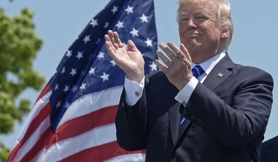 President Donald Trump applauds at the commencement exercises at the U.S. Coast Guard Academy in New London, Conn., Wednesday, May 17, 2017, where he also gave the commencement address. (AP Photo/Susan Walsh)